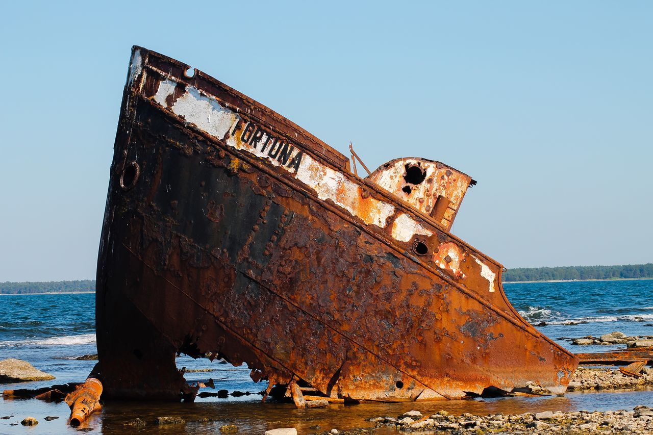 shipwreck, sea, nautical vessel, abandoned, rusty, damaged, ship, run-down, obsolete, transportation, deterioration, boat, beach, water, nature, mode of transport, no people, sinking, bad condition, outdoors, sunken, crash, sky, day, clear sky, beauty in nature, sailing ship