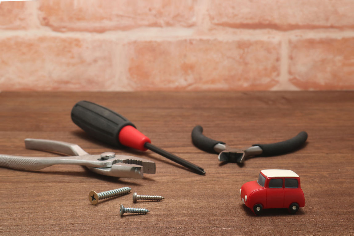 Automobile Business Car Check This Out Close-up Drive Indoors  Inspection Maintenance Mechanic Miniature No People Pliers Remodeling Renovation Repairs Studio Shot Table Tire Tools Toy Toy Car Transportation Vehicle Wrench