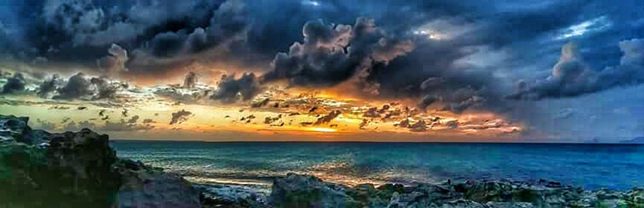 cloud - sky, sea, dramatic sky, sunset, sky, nature, horizon over water, scenics, outdoors, no people, tranquil scene, beauty in nature, horizon, multi colored, water, beach, city, day