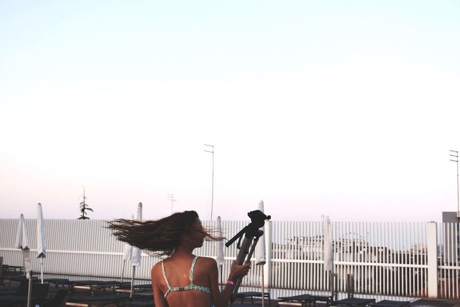 My girl with camera tripod and horziontal hair. Camera Tripod Tripod Jesolo Girl Hair Freedom Horizontal