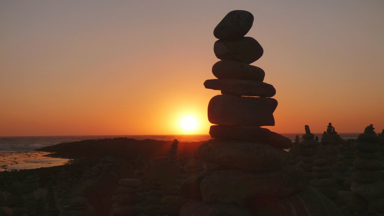 EyeEm Selects Sunset Silhouette Outdoors Sky Scenics Rocks And Water Zen Rock At Beach Portugal Summer Views Summer 2017 EyeEm Selects Sunset Silhouettes Balance Stack Zen Rock - Object Sun Afternoon Afternoon Lights Day Zen Rock At Sunset Zen Rock On Beach Nature Paint The Town Yellow