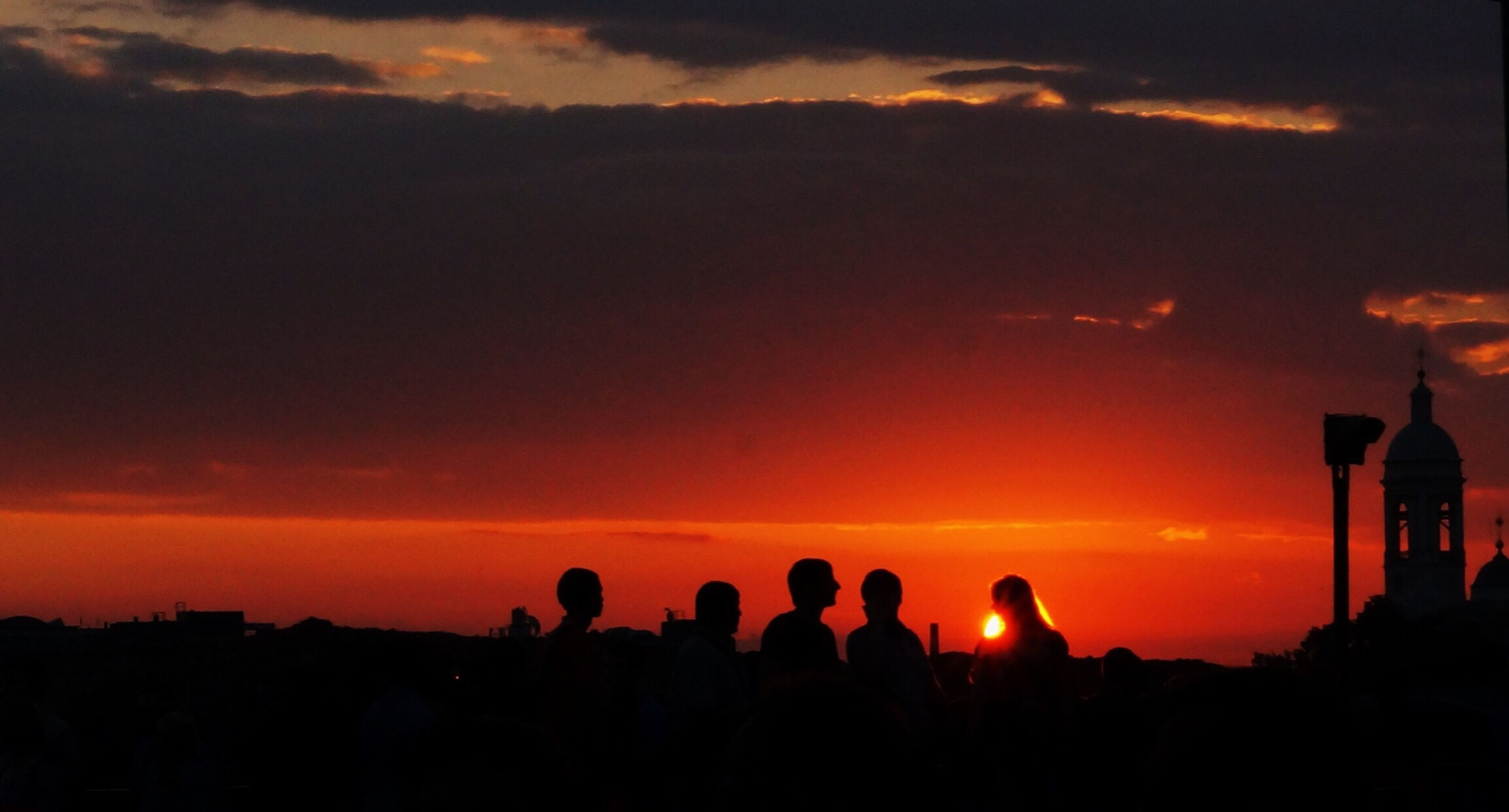 silhouette, sunset, sky, large group of people, lifestyles, orange color, men, leisure activity, cloud - sky, togetherness, person, dramatic sky, scenics, beauty in nature, standing, cloud, dusk, enjoyment, outdoors
