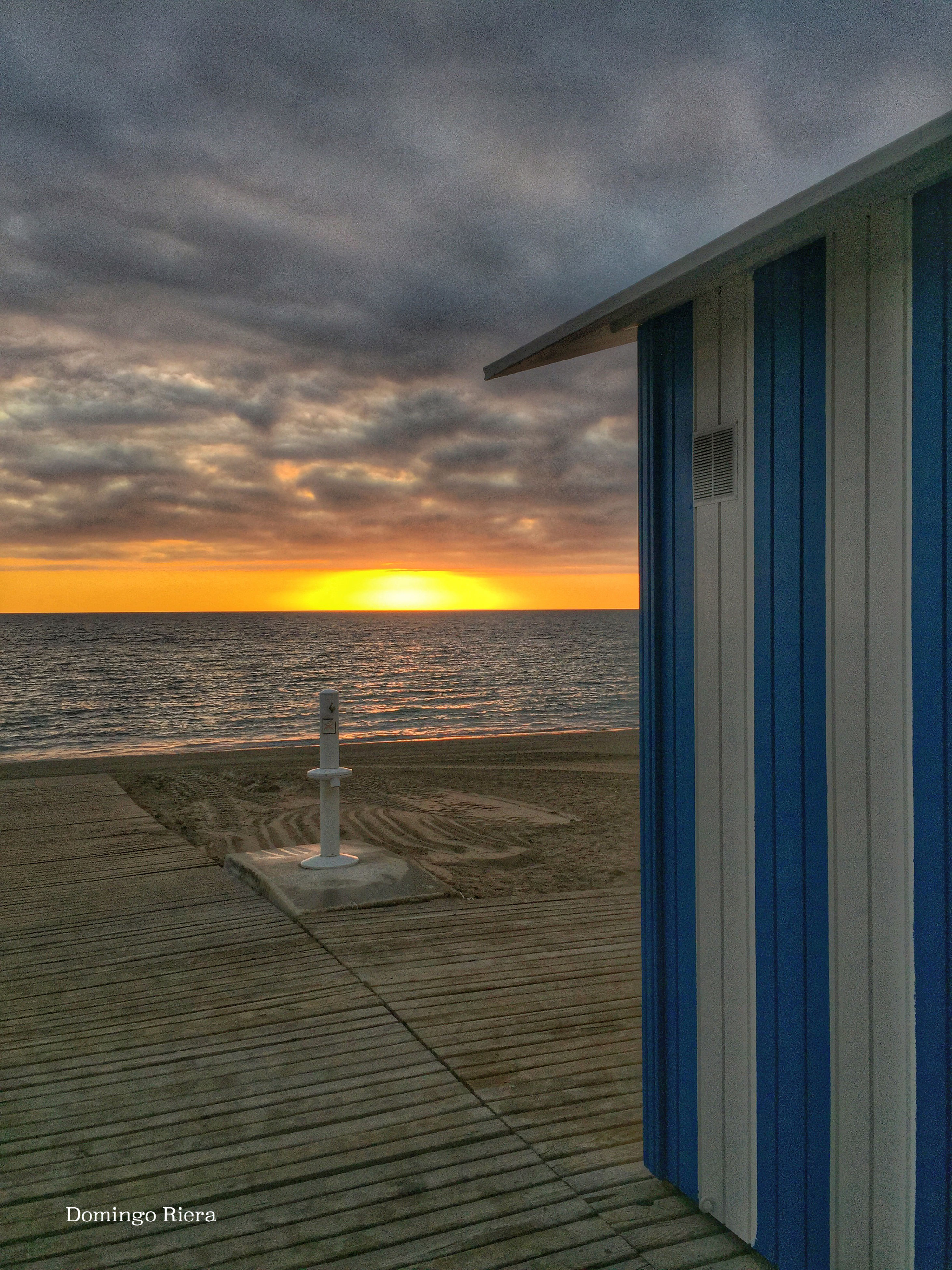 sea, horizon over water, sunset, sky, water, beach, cloud - sky, scenics, tranquil scene, beauty in nature, tranquility, orange color, shore, built structure, nature, idyllic, cloud, architecture, cloudy, dramatic sky