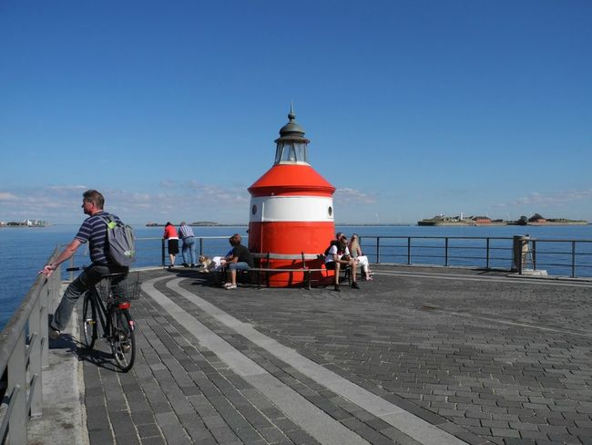 The Red Lighthouse at Langelinie in Copenhagen on the island of Zealand in Denmark - Full Length Transportation Bicycle Clear Sky Mode Of Transport Land Vehicle Riding Lifestyles Casual Clothing Men Blue Togetherness Cycling Day Lighthouse Langelinie Copenhagen Denmark TakeoverContrast