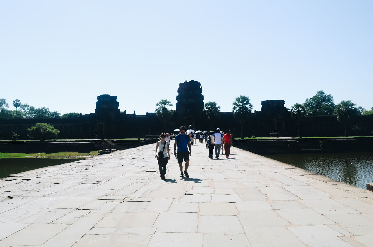 Angkor Thom Architecture ASIA Cambodia Clear Sky Day Diminishing Perspective Footpath Full Length Leisure Activity Lifestyles Outdoors Paving Stone Pedestrian Walkway Person Silhouette Sky Summer Sun The Way Forward Travel Travel Destinations Tree UNESCO World Heritage Site Walking