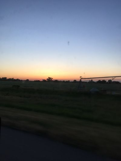 Sunset Landscape Scenics Tranquil Scene Field Nature Beauty In Nature No People Tranquility Outdoors Sky Silhouette Clear Sky Transportation Car Tree Grass Day Nebraska Moving Picture