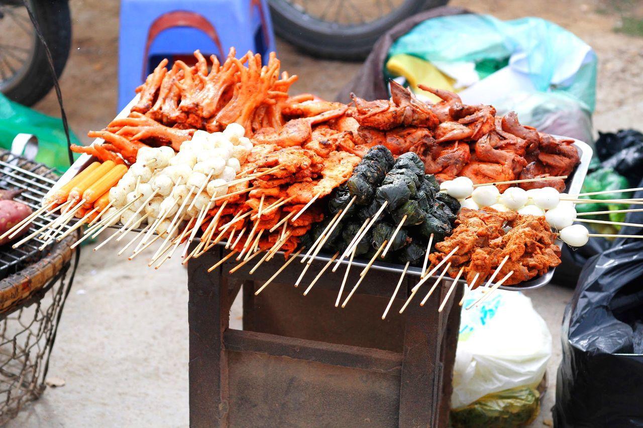 High Angle View Of Street Food On Metal Grate