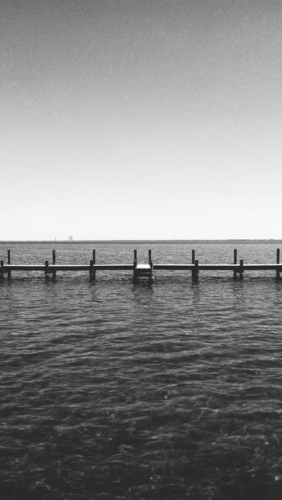 Sea Water Horizon Over Water Silhouette Tranquility Outdoors Sky Nature Sunset Scenics Clear Sky No People Beauty In Nature Day River View Dockside Wood - Material Waterfront Water Surface Black & White Photography Tranquility Florida Reflection EyeEmNewHere The Great Outdoors - 2017 EyeEm Awards Neighborhood Map BYOPaper!