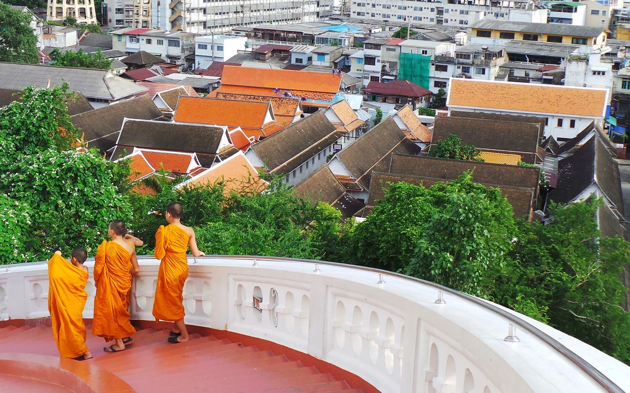 Architecture Spotted In Thailand Bangkok Boys Buddhist Buddhist Monks Built Structure City High Angle View Looking Down Monks Orange Railing Religion Rooftops Stairs Steps Temple Thailand Youth Colors Colorful Buildings Curved Stairs Travel Photography