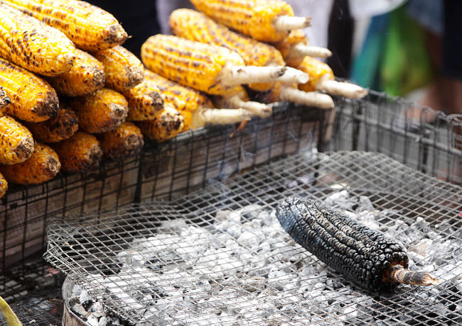 The exiled corn Close-up Cooking Corn Day Exile Focus On Foreground Food Foodphotography Freshness Grill No People Overcooked Street Life Streetphotography EyeEm Diversity