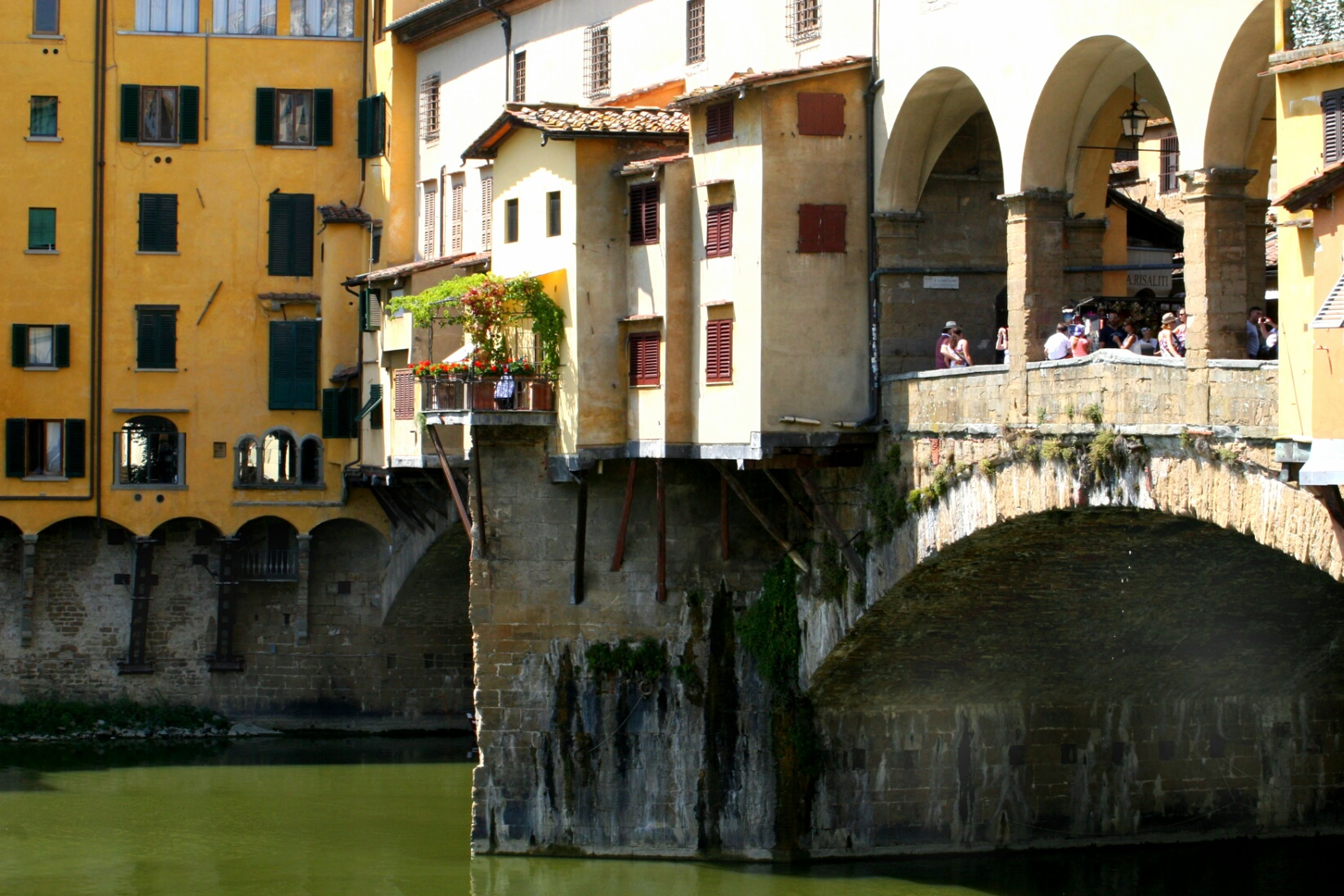 architecture, built structure, building exterior, arch, building, water, history, facade, city, canal, arched, window, reflection, outdoors, old town, architectural column, incidental people, day, travel destinations, historic