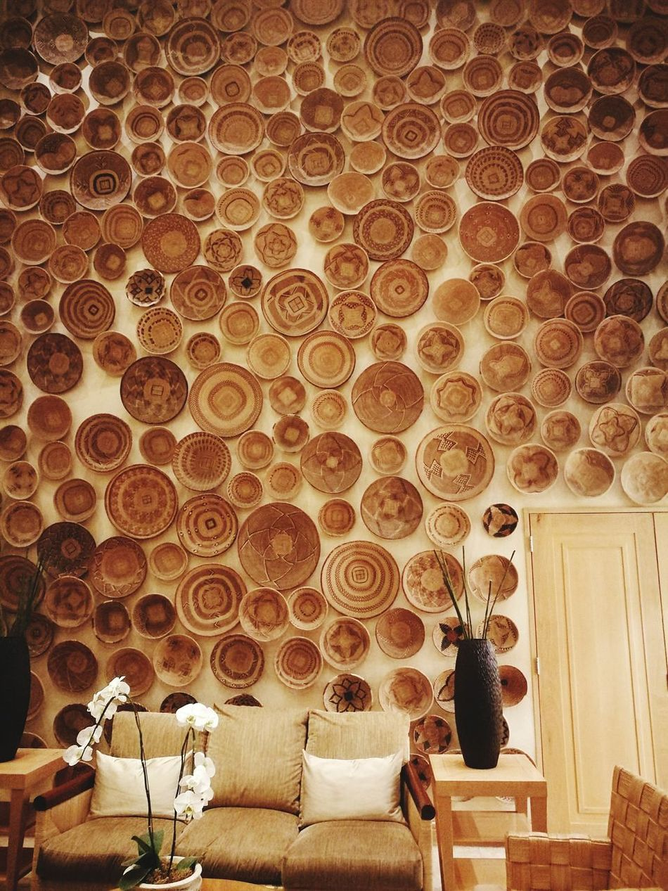 Beautifully Organized Couch Woven Baskets Covered Wall