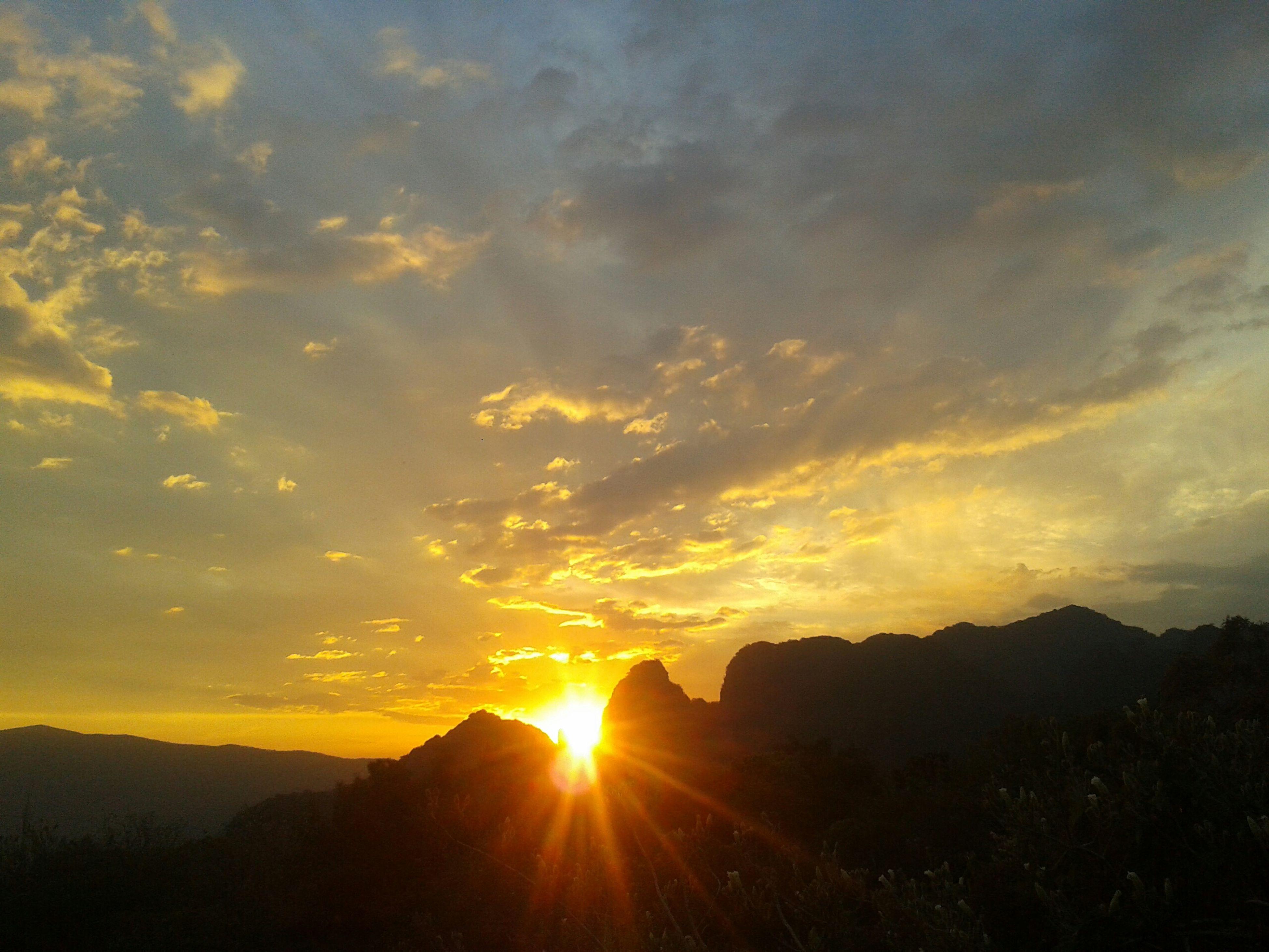sunset, sun, scenics, silhouette, tranquil scene, beauty in nature, sky, sunbeam, tranquility, sunlight, mountain, orange color, cloud - sky, landscape, nature, idyllic, cloud, lens flare, mountain range, outdoors