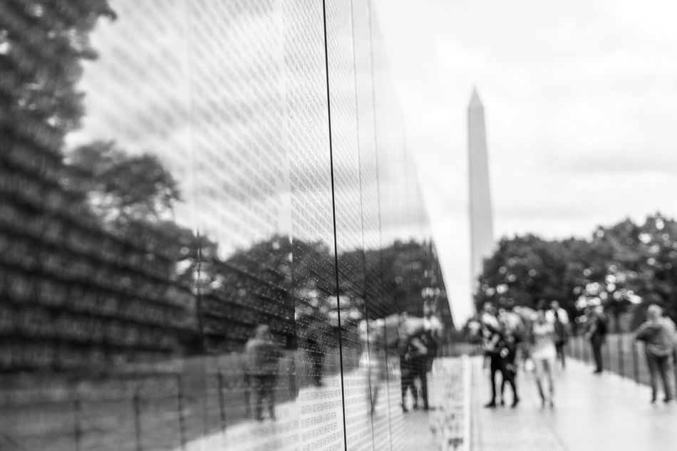 Alrington City City Life Day District Of Columbia Dramatic Angles Footpath Honor Guard International Landmark Memorial Monochrome Photography Old Guard Outdoors Person Rain Sightseeing Sky Suspension Bridge Tree Walking Washington Washington, D. C. Water Vietnam War Memorial The City Light