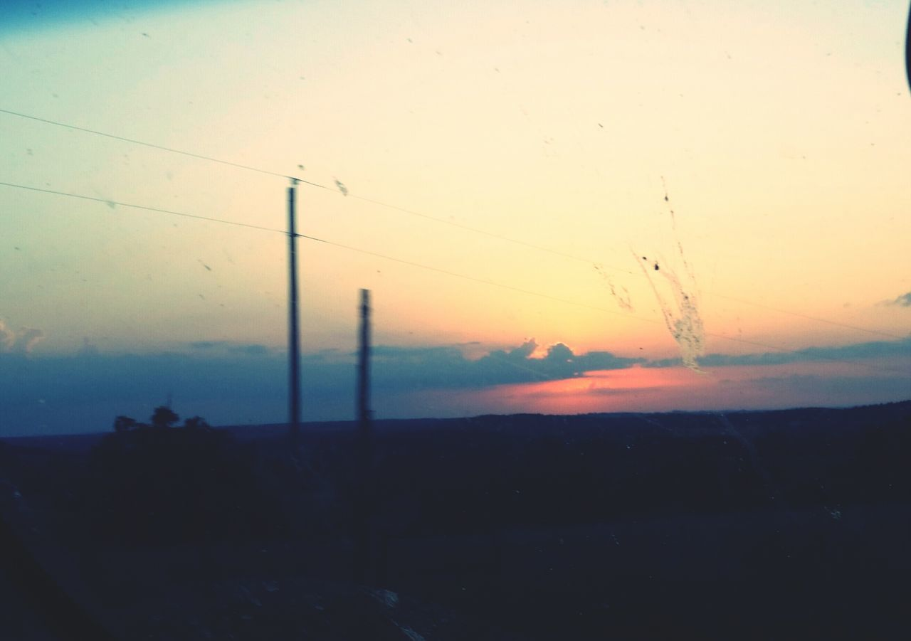 sunset, sky, nature, beauty in nature, silhouette, tranquil scene, scenics, tranquility, no people, landscape, outdoors, telephone line, day