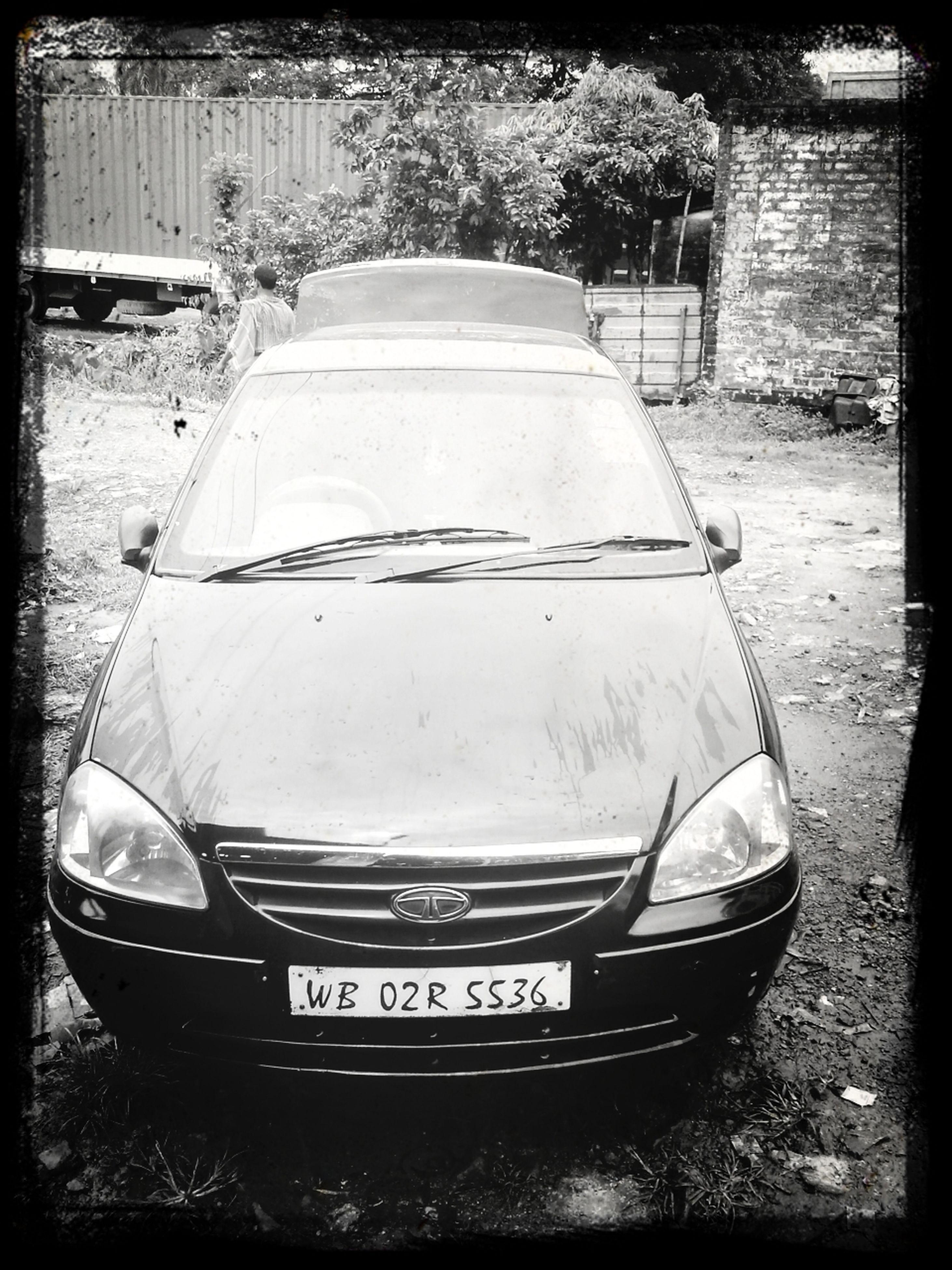 transportation, mode of transport, transfer print, nautical vessel, auto post production filter, boat, car, moored, land vehicle, text, day, western script, outdoors, no people, street, travel, tree, communication, water, old