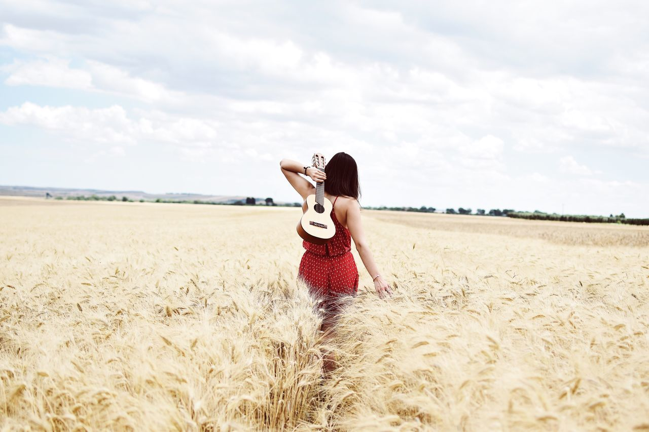 TakeoverMusic Cereal Plant Field One Person Rural Scene Growth Landscape Sky Standing Beauty In Nature Cloud - Sky Scenics Agriculture Nature Day Young Adult Wheat Outdoors People Adult