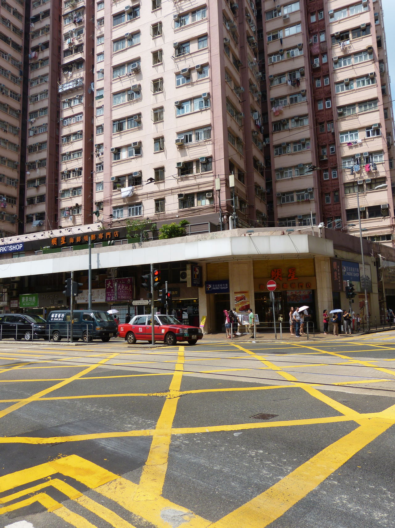 Apartment Architecture Building Exterior Built Structure Business Finance And Industry City City Life City Street Crossroad Crossroads Crossroads Of The World Day Façade No People Outdoors Road Skyscraper Street Taxi Transportation Tree