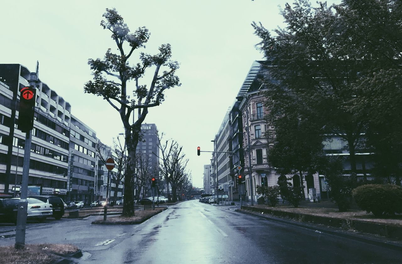 The Street Photographer - 2017 EyeEm Awards Red & Rain Red Light Rainy Days City Life City Street Streetphotography Rain The Way Forward Road Architecture Building Exterior Outdoors No People Road Sign