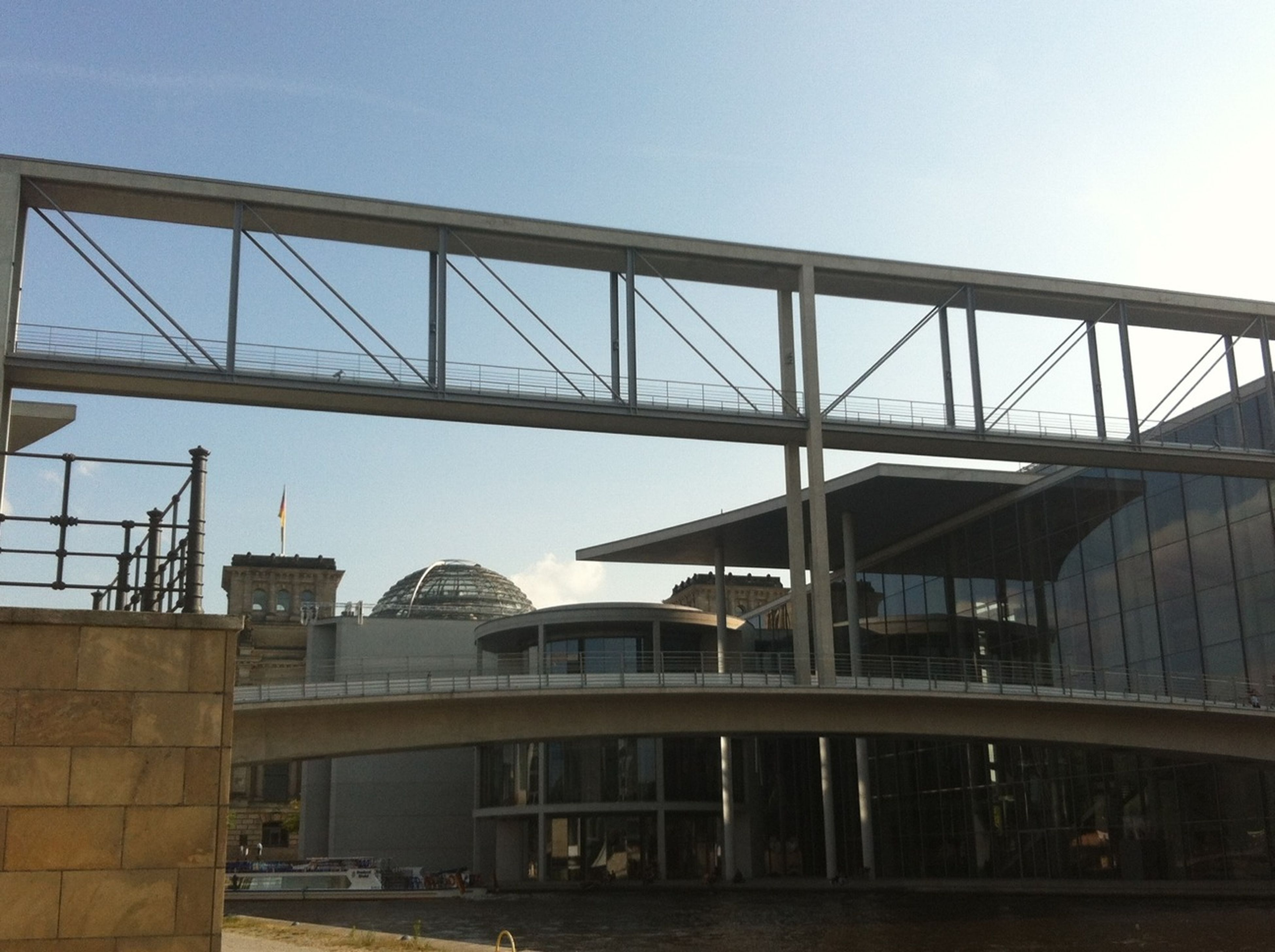 architecture, built structure, building exterior, clear sky, bridge - man made structure, city, connection, low angle view, copy space, engineering, bridge, river, sky, building, outdoors, day, no people, railing, modern, residential building