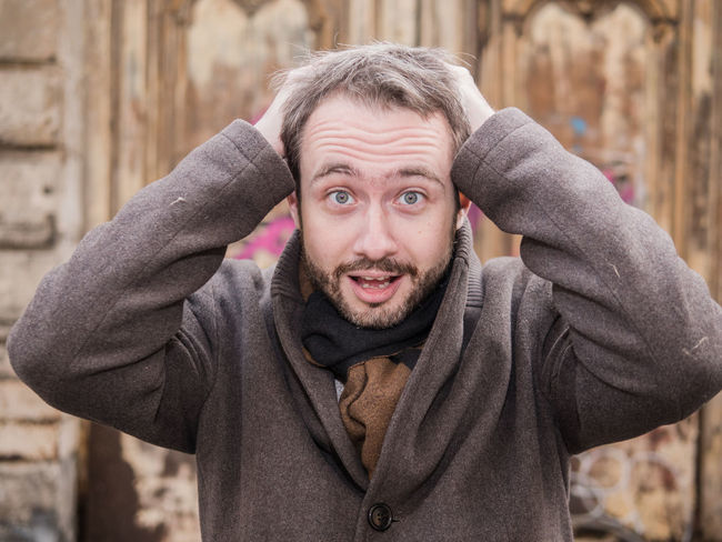 Man looks in despair and almost tears his hair off Cry Hair Looking At Camera Beard Casual Clothing Close-up Despair Desperation Headshot Lifestyles Look Looking At Camera One Person Outdoors People Portrait Real People Shout Warm Clothing Young Adult