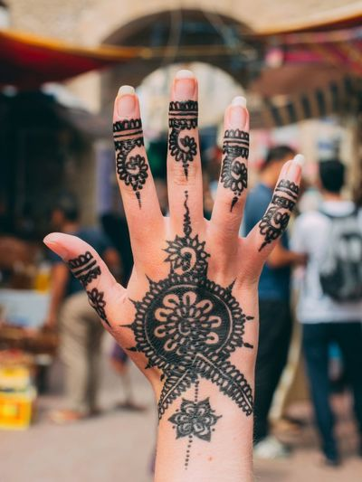 Human Hand Tattoo Human Body Part Cultures Body Adornment One Person Lifestyles Ink Focus On Foreground Celebration Individuality Close-up Artist Real People People Adults Only Adult Indoors  Day (null)Outdoor Holiday Essaouira Morocco Africa