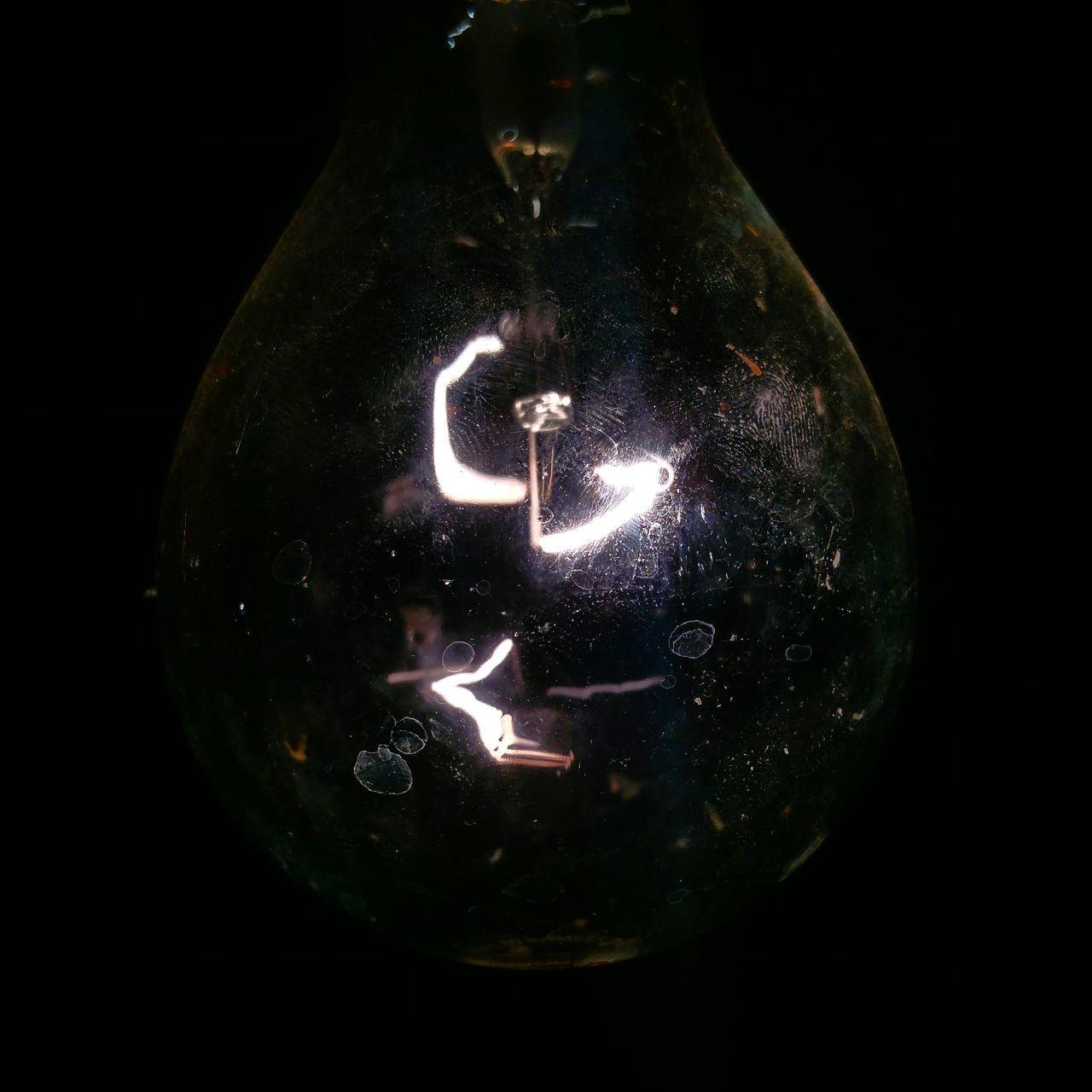 close-up, black background, illuminated, no people, lighting equipment, light bulb, studio shot, electricity, filament, indoors