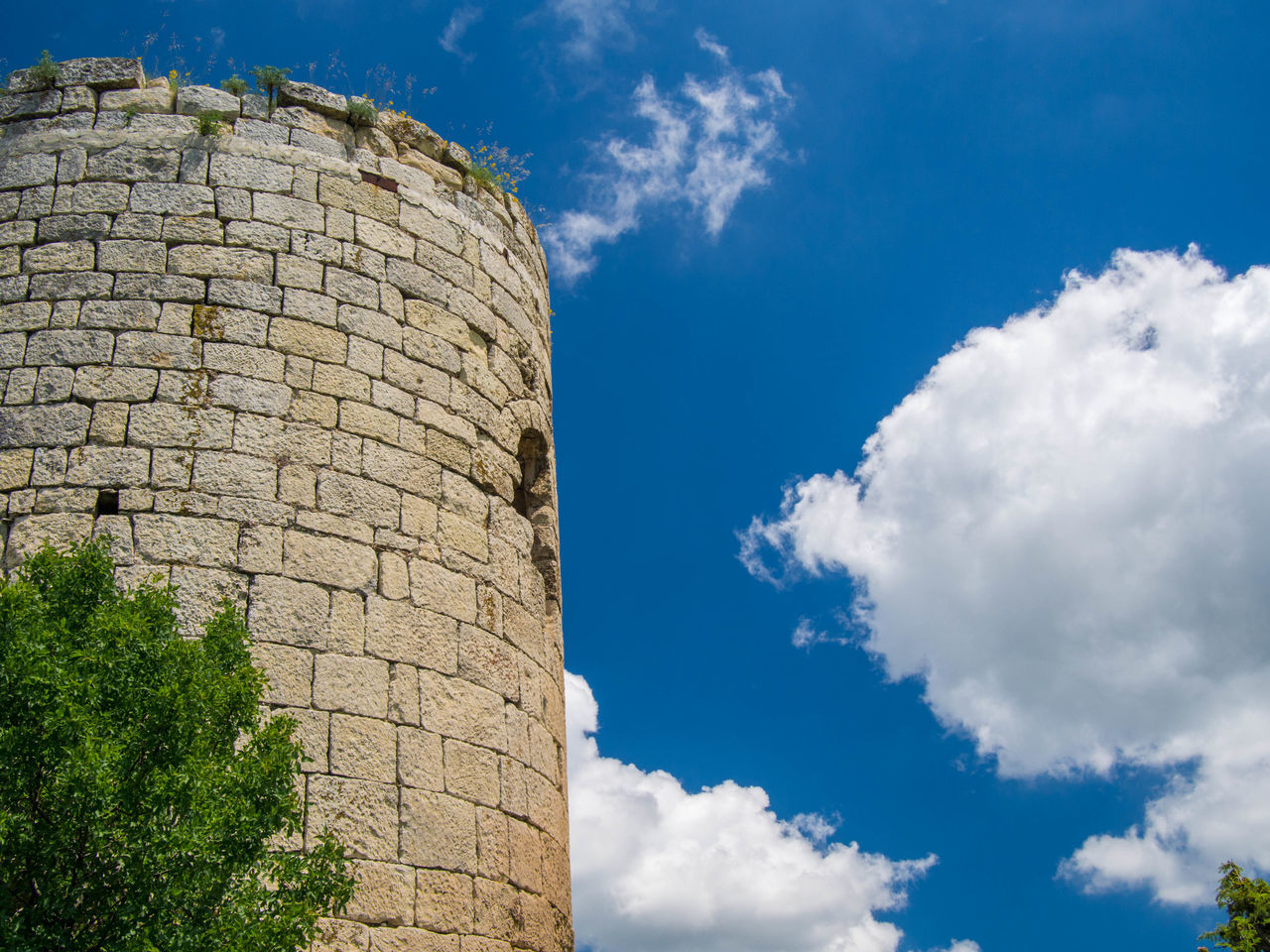 history, old ruin, sky, cloud - sky, ancient, architecture, low angle view, the past, day, built structure, archaeology, ancient civilization, outdoors, travel destinations, no people, building exterior, nature, tree
