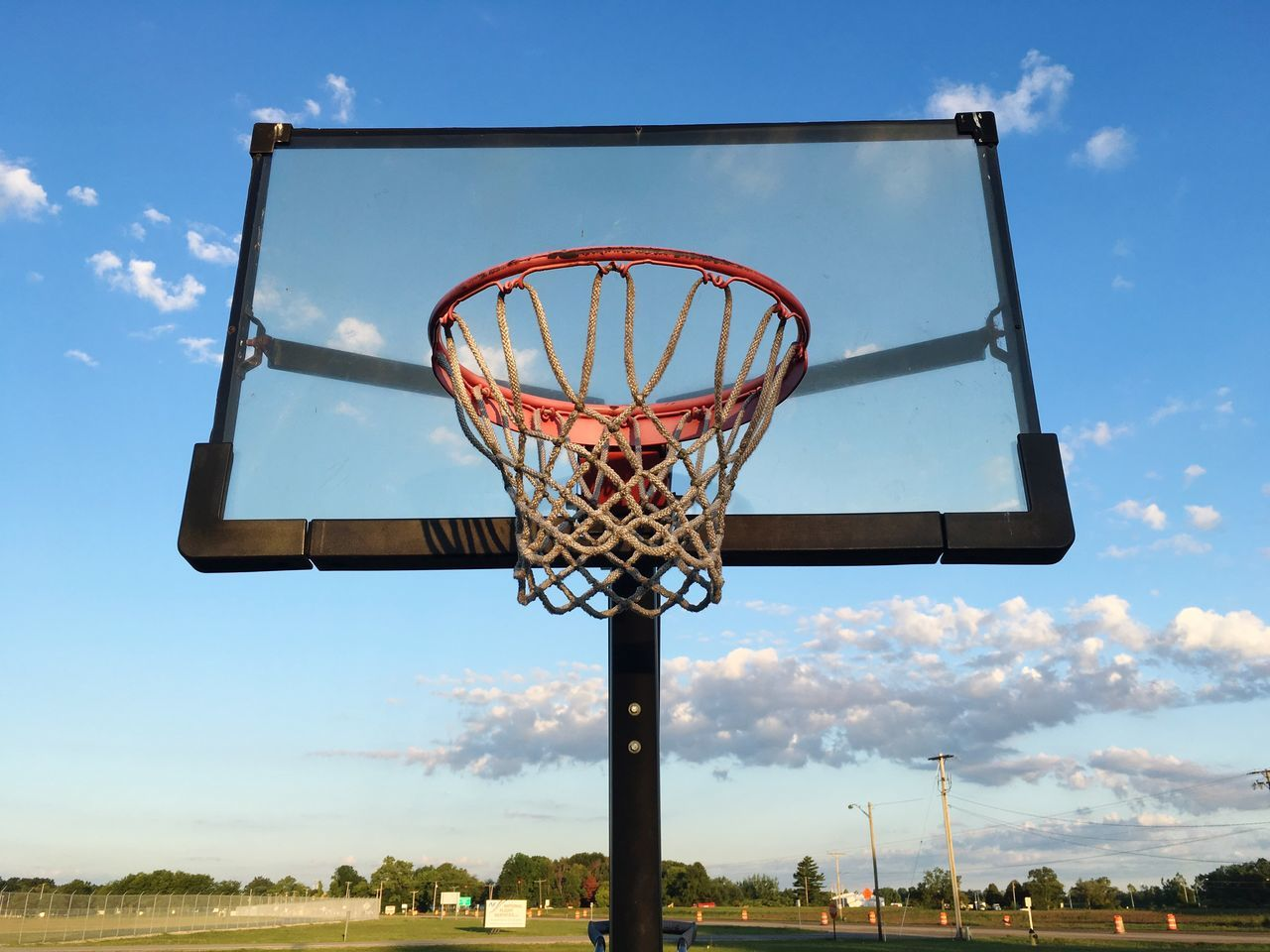 EyeEm Selects Basketball - Sport Basketball Hoop Sport Sky Basketball Low Angle View Cloud - Sky Day Making A Basket Blue Outdoors Court Taking A Shot - Sport Net - Sports Equipment Skill  Scoring Basketball Player No People