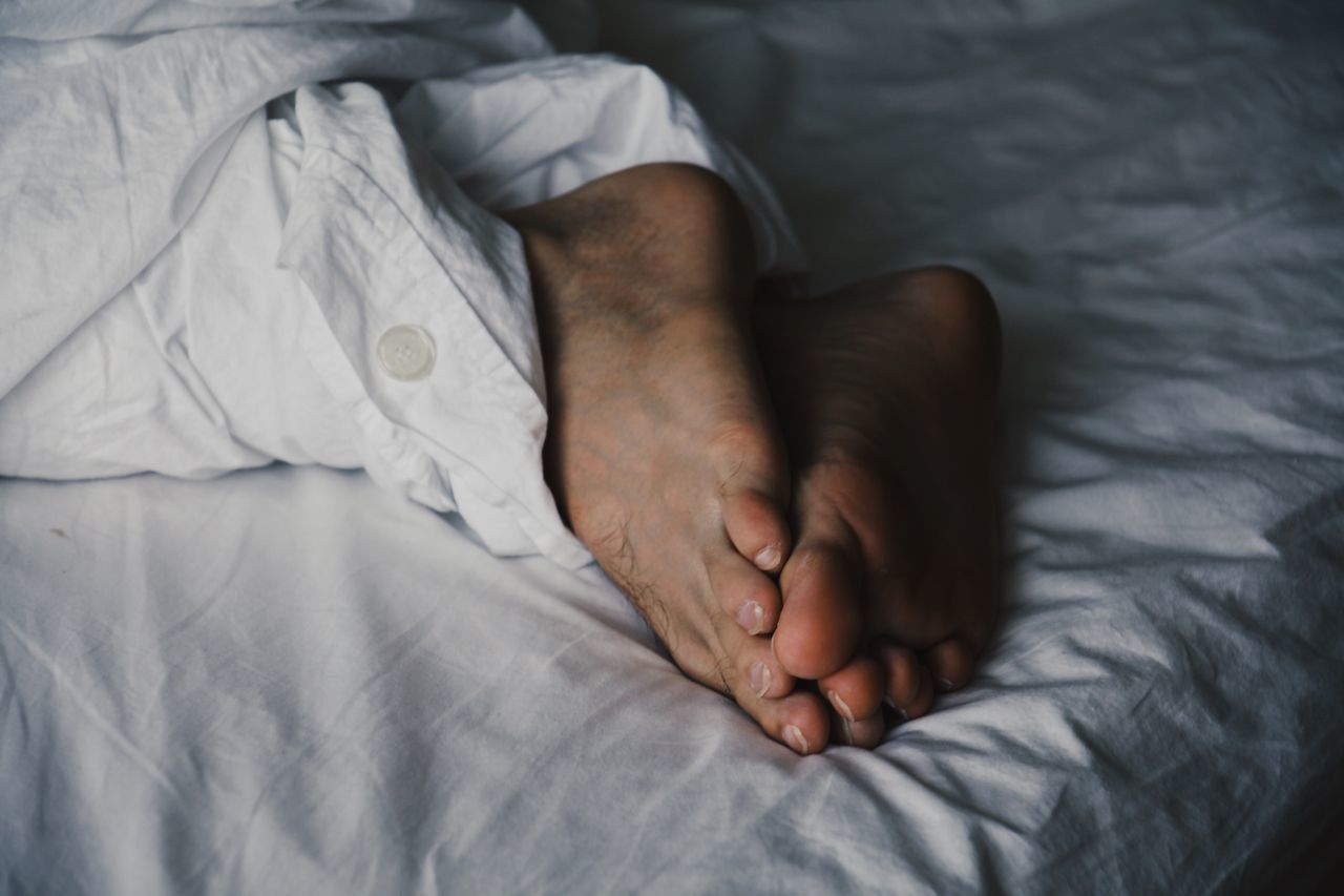 EyeEm Selects EyeEm Selects Bed Bedroom Sheet Indoors  Sleeping Toronto Canada Real People Resting Lying Down One Person High Angle View Home Interior Barefoot Comfortable Sole Of Foot Low Section Lifestyles Pillow Close-up Human Body Part Open Edit Feet