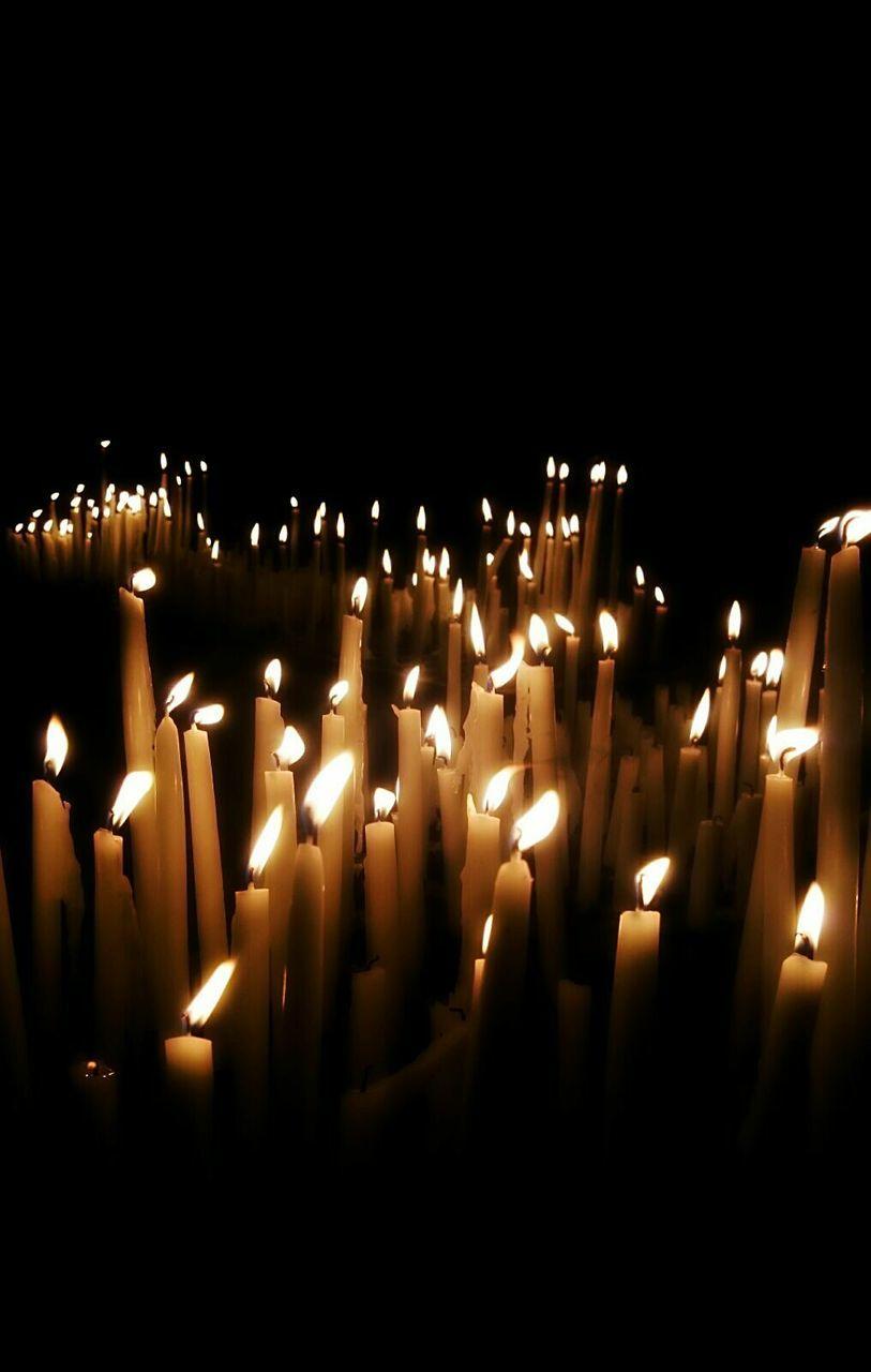 candle, flame, burning, heat - temperature, glowing, spirituality, religion, no people, darkroom, illuminated, place of worship, indoors, close-up, black background
