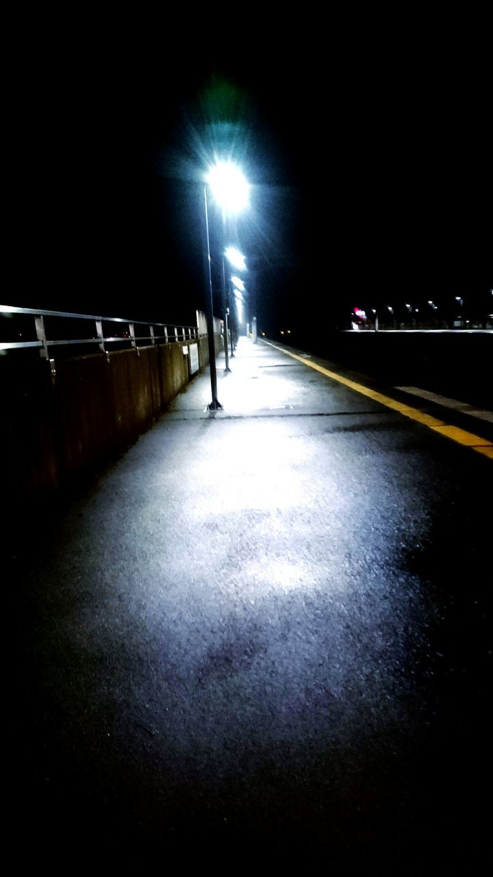 illuminated, night, real people, the way forward, transportation, one person, full length, outdoors, people