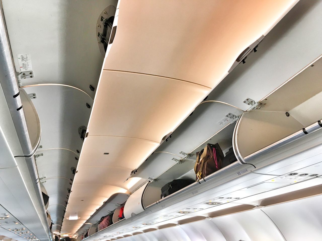 Overhead lockers in a passenger jetliner. Ceiling Air Vehicle Low Angle View Airplane Overhead Lockers Overhead Storage Jetliner Airliner Storage Travel Air Travel  Holiday Holidays No People Break The Mold Transportation Carry On Baggage