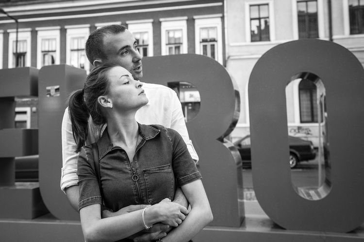 Architecture B&w Blackandwhite Blackandwhite Photography Built Structure Day Hug Hugging A Tree Indoors  Lifestyles Low Angle View Outdoors Real People Street Streetphotography Two People Urban Young Adult Young Men Young Women