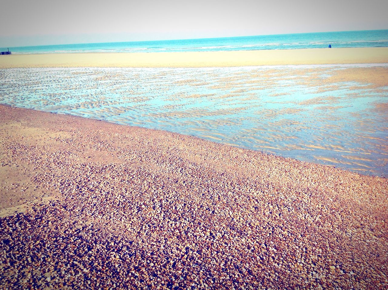 sea, beach, horizon over water, water, shore, scenics, nature, beauty in nature, sand, tranquil scene, tranquility, sky, outdoors, wave, day, no people, vacations, pebble beach