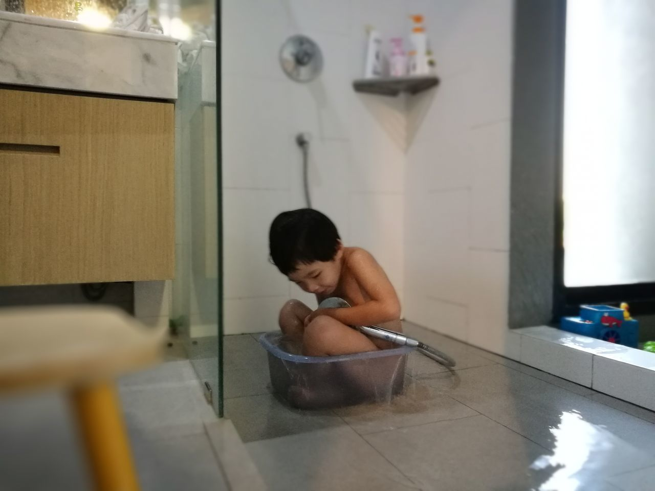 Indoors  Body Care Domestic Room Lifestyles One Person Hygiene Domestic Bathroom Adults Only Bathroom People Domestic Life Adult Only Men Day Kid Boy Play Water Bathing Bath