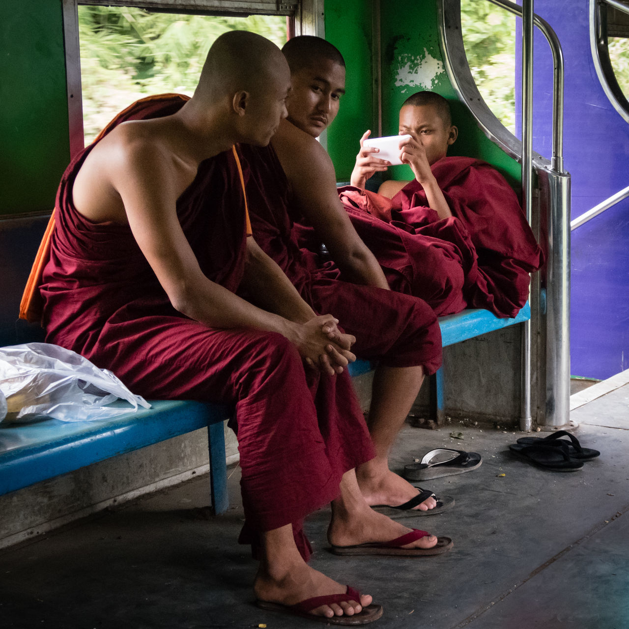 Buddhism Burma Circle Line Commuters Commuting Cultures Day Monks Myanmar Novice Monk Novices On The Train Real People Religion Religion And Beliefs Street Photography Togetherness Yangon Young Adult Young Adults Miles Away Mobile Conversations