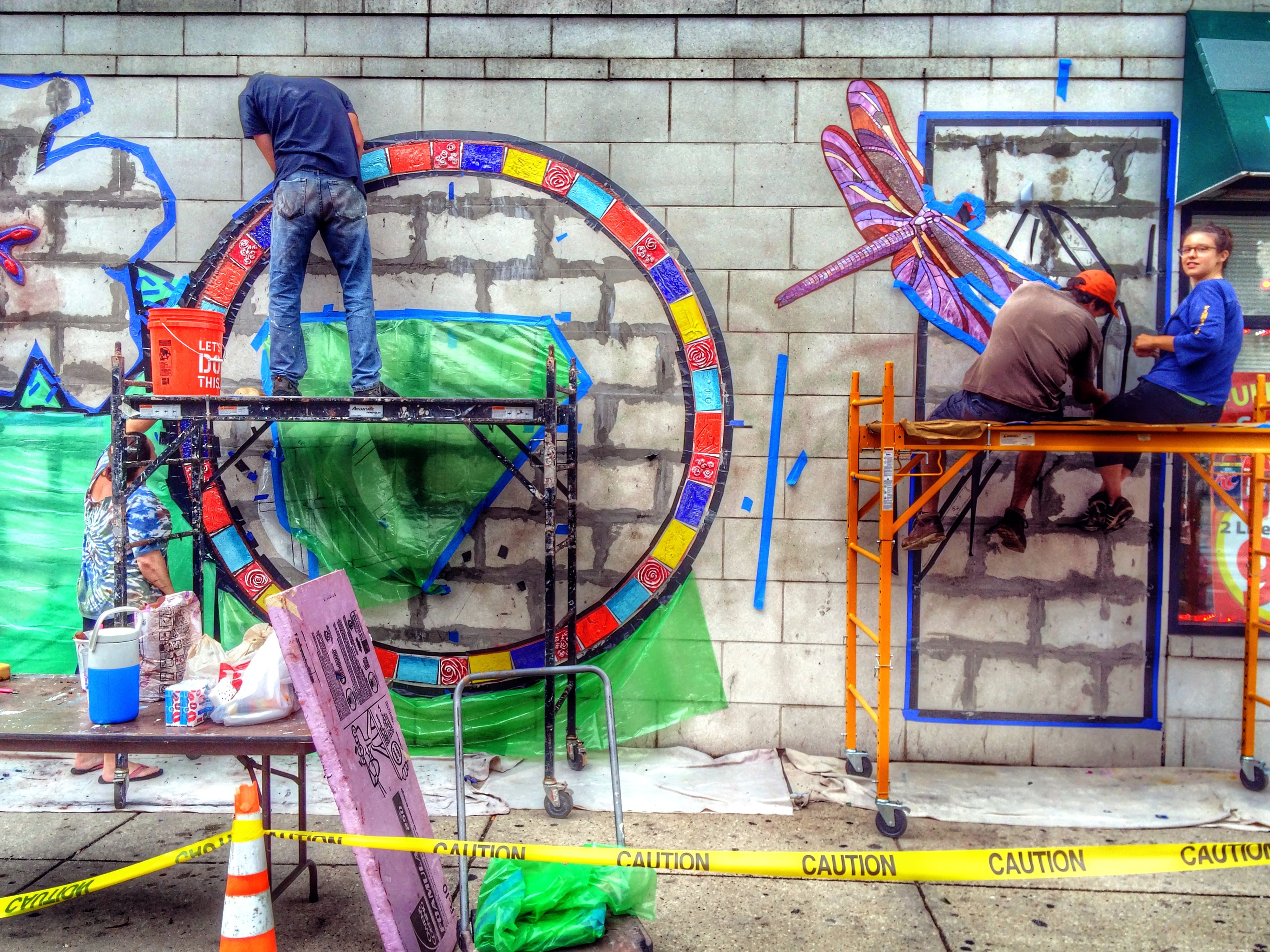 graffiti, art and craft, art, creativity, built structure, architecture, wall - building feature, building exterior, human representation, multi colored, street art, bicycle, street, wall, mural, blue, day, outdoors, sculpture