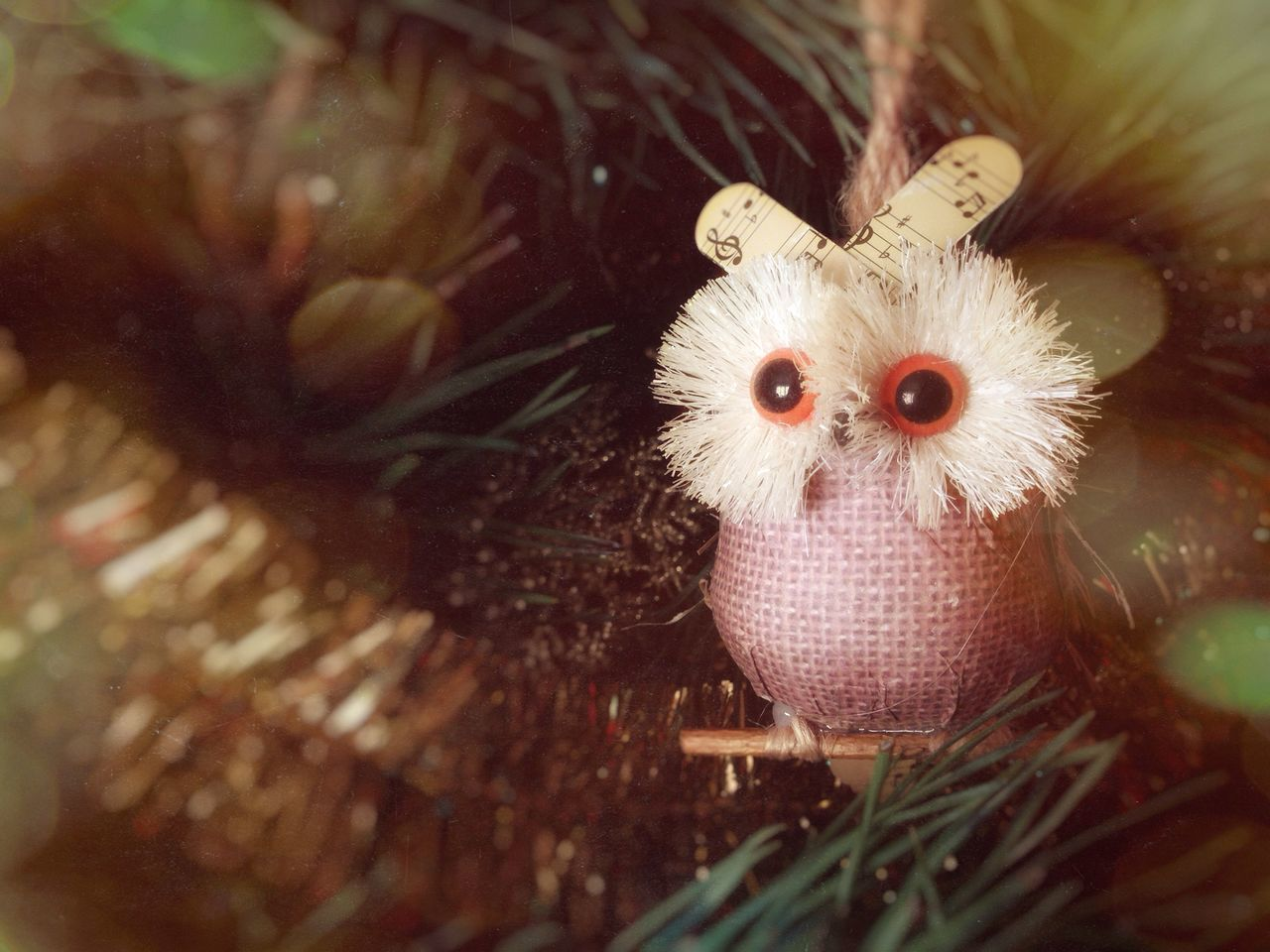 Close-Up Of Bird Figurine On Christmas Tree