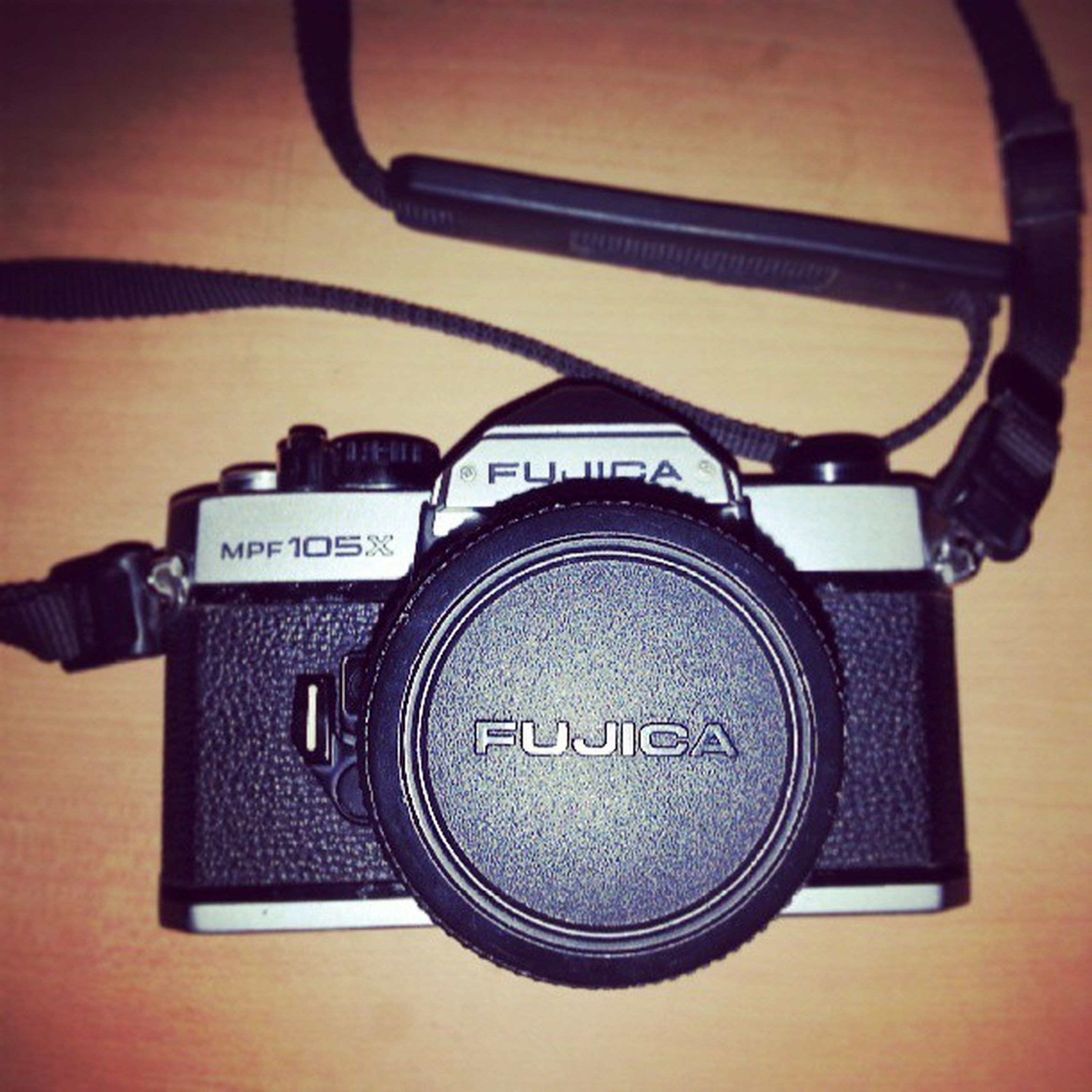 technology, communication, indoors, photography themes, close-up, wireless technology, camera - photographic equipment, old-fashioned, connection, retro styled, music, number, lens - optical instrument, single object, metal, arts culture and entertainment, digital camera, photographing, equipment, telephone