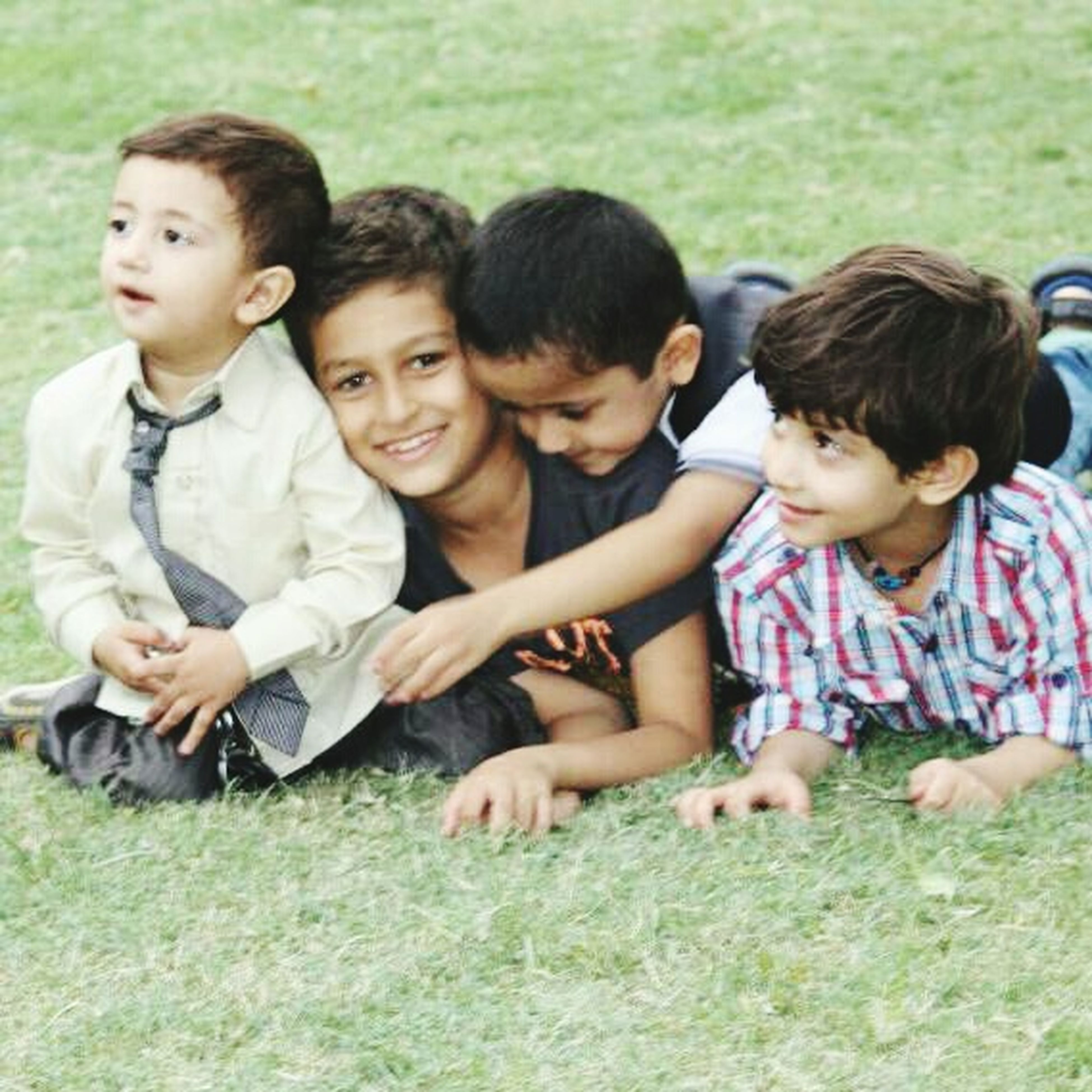 togetherness, bonding, childhood, leisure activity, lifestyles, person, love, elementary age, girls, family, boys, grass, casual clothing, smiling, happiness, friendship, sibling, innocence