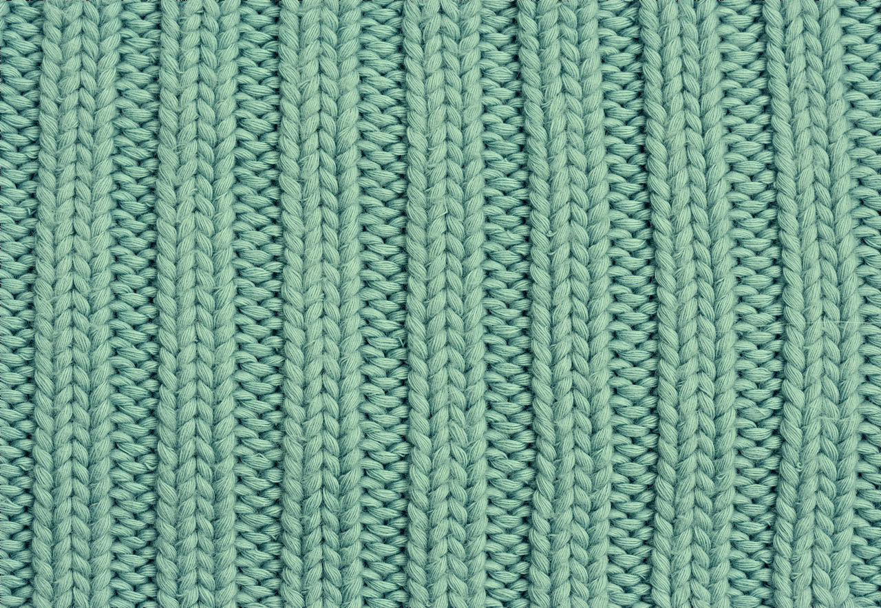Close-up of a woolen pattern - knitting pattern with purls and knits Art And Craft Background Backgrounds Casual Clothing Close-up Clothing Detail Fashion Full Frame Green Color Green Color Knit Knitted  Knitting No People Pattern Relief Row Seamless Pattern Simplicity Symmetry Textile Textured  Warm Clothing Wool