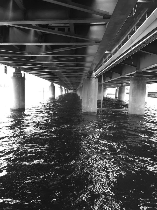 EyeEm Best Shots Shadows Minimalism Minimalist EyeEm EyeEm Black&white! EyeEm Team Bw_collection Streetphoto_bw EyeEm Bnw Minimalism_bw Architecture Connection Built Structure Architecture Water Bridge - Man Made Structure Engineering River Waterfront Low Angle View Architectural Column SUPPORT Bridge Rippled Reflection Long Below Underneath Flowing Water Day Wave