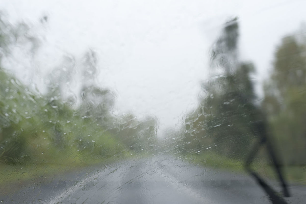 a car windscreen and windsceen wiper obscured with heavy rain Bad Car Driving Conditions Drops Hazard Obscured Danger Opaique Poor  Rain Splash Storm Visibility