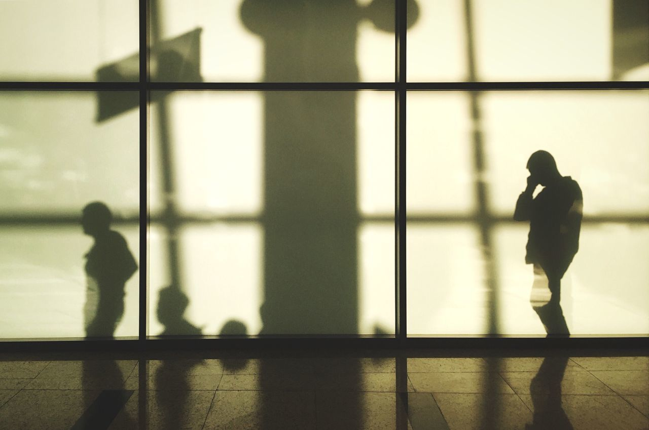 Shadow Of Man Talking On Mobile Phone On Sheremetyevo International Airport