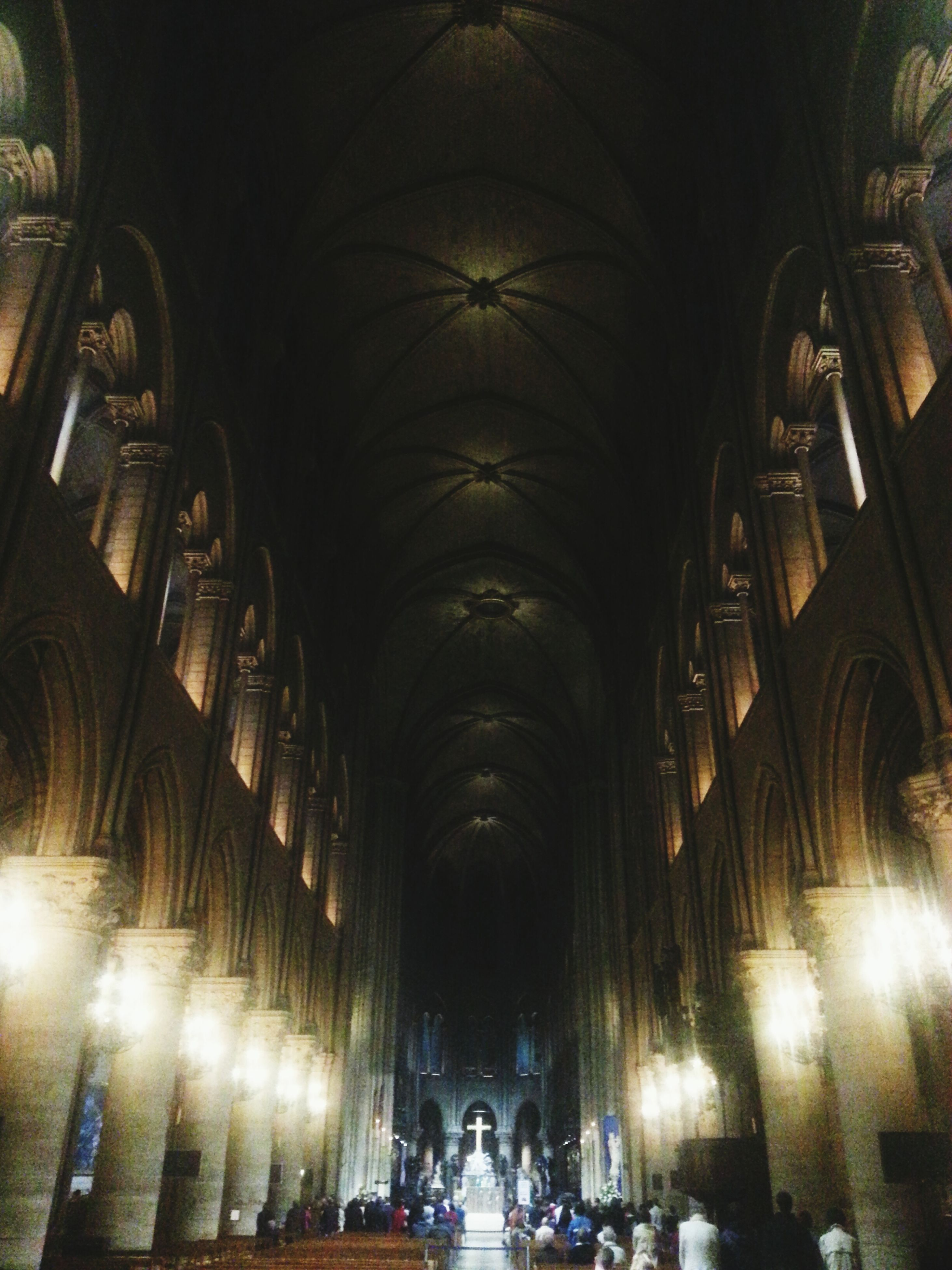 indoors, arch, ceiling, architecture, illuminated, built structure, men, large group of people, interior, lifestyles, travel, person, place of worship, history, famous place, religion, architectural column, leisure activity, tourism