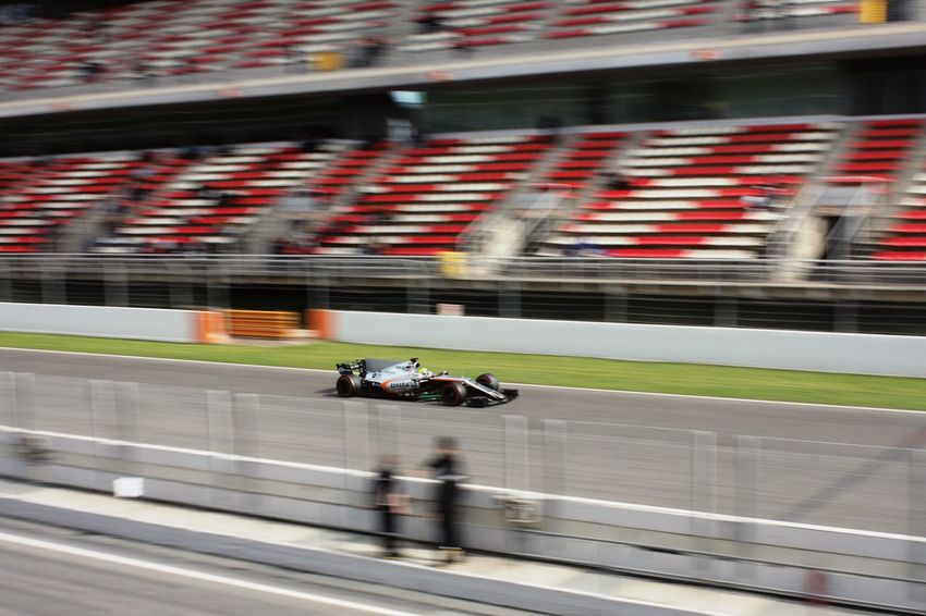 Speed Sports Race Blurred Motion Motion Sport Competition Crash Helmet Motor Racing Track Sports Track Adults Only Driving One Person Competitive Sport Outdoors Photography Catalunya Barcelona SPAIN Formula 1 Forceindia Race Car Team Working Repetition