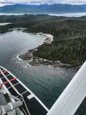 #islandsofbeauty Beauty In Nature Day Explorebc Float Plane Haida Gwaii High Angle View Mountain Nature Nautical Vessel No People Outdoors Queencharlotteislands Scenics Sea Sea Plane Sky Transportation Water