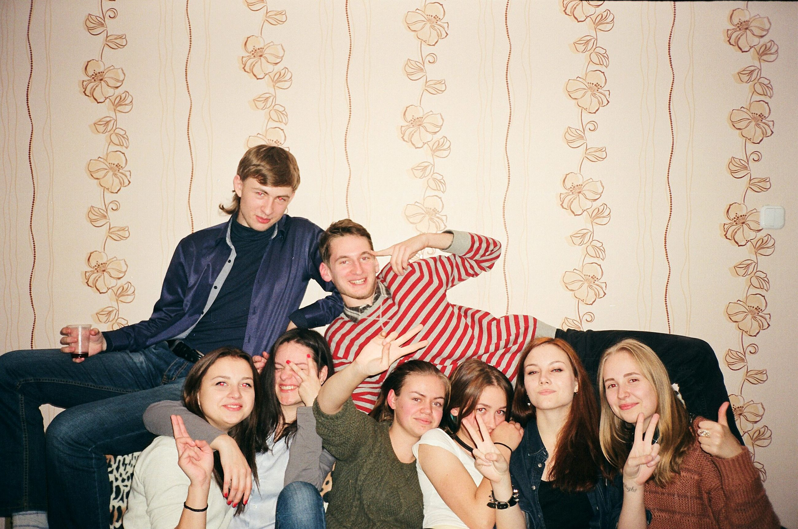 celebration, indoors, party - social event, wallpaper, happiness, looking at camera, fun, portrait, people, cheerful, togetherness, smiling, friendship, lifestyles, blond hair, young adult, men, adult, real people, young women, adults only, day
