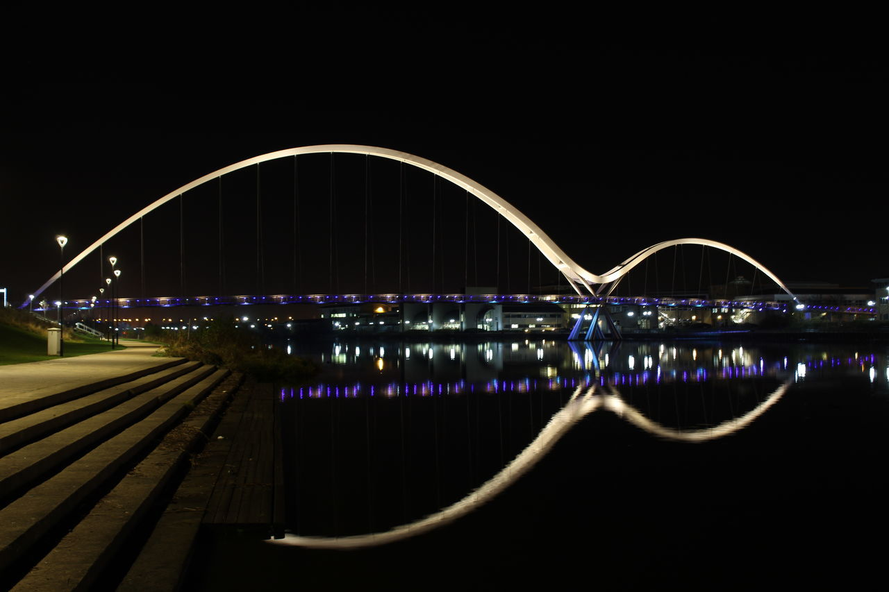 Architecture Bridge - Man Made Structure City Communication Connection Illuminated Infinity Bridge Light Trail Night No People Outdoors Water